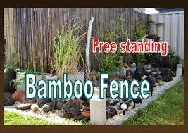 free standing bamboo fence installation in the garden liz kreate you