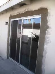 post construction cleaning of sliding glass door after stucco patch