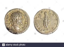 Old ancient coin coins AR Silver Denarius Emperor Septimius Severus  (reverse) Victory holding an olive branch over Parthia 201 AD Stock Photo -  Alamy