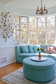 beautiful curved sofa with blue pillows and blue ottoman table as bay window furniture small sized bay window furniture