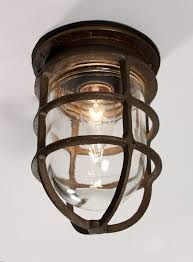 sold antique industrial cast bronze cage light fixture with original glass signed oceanic