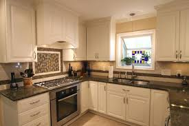 image of white kitchen cabinets with gold granite countertops
