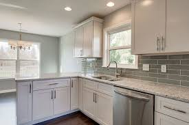 modern kitchen with santa cecilia white granite