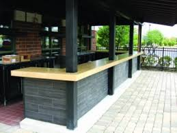 this precast outdoor bar countertop by fishstone studio was designed in five pieces to accommodate the shape and existing support poles show caption