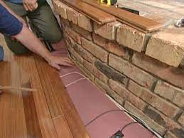 to install flooring around a fireplace