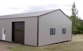 this building is a 32x60x12 pole shed 2 10 10 garage doors 2 3 ft service doors and 8 windows the colors are antique bronze roof and trim with hickory
