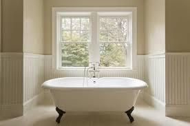 claw foot bathtub in window nook