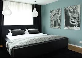 view in gallery black contrasts a soothing blue green bedroom wall black furniture