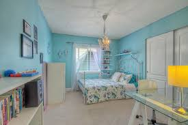beautiful girls bedroom with chandelier and blue painted walls with chandelier teenage bedroom