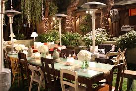 outdoor outdoor wedding lights decorations with long tables and wooden chairs also small floor lamp