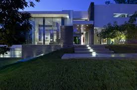 View modern house lights Designs Night View Front Entry Steps Up To Large Glass Fronted Modern House Whipple Russell Architects Summit House Whipple Russell Architects