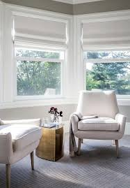 window chair furniture. Chic Bay Window Bedroom Sitting Area Boasts A Pair Of Modern White Chairs Flanking Brass Accent Table, Jonathan Adler Teardrop Table. Chair Furniture E