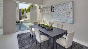 grey dining room decor with funky crystal chandeliers for open floor plan with sliding glass door