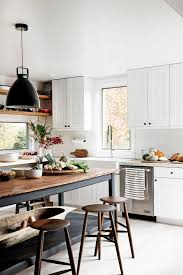 farmhouse kitchen industrial pendant. long table makes this kitchen looks so comfortable and inviting black pendant light white farmhouse industrial u