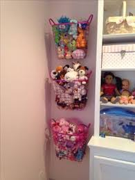 Organizing Stuffed Animals - spray painted metal baskets - attached to the  wall with hooks,