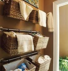 Attach rails to your bathroom's wall to hang up baskets that'll help  organize/