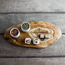 olive wood chopping cheese board by the rustic dish