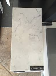 Small Picture Caesarstone marble look alike countertop with potential although