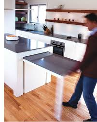 this kitchen island with a pull out table was actually my client s idea he