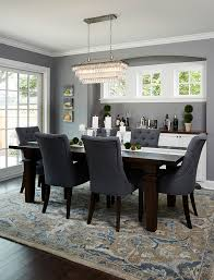dining room with dark wood floors beautiful patterned rug and blue chairs and dark wood table benjamin moore deep silver 2124 30
