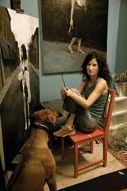 photo of katie o hagan in her studio with her dog seamus contemporary portrait artist