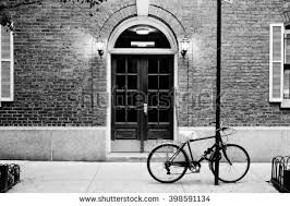 city apartment building entrance. beautiful building. entrance door and bicycle, manhattan new york. classic apartment building in city