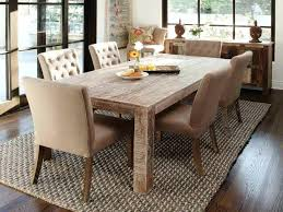 large wooden dining table laminate flooring rustic chairs wicker area rugs kitchen room tables
