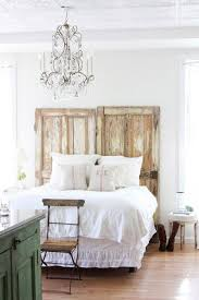 There are myriad ways you can DIY your own headboard (including  upholstering with a wool Army blanket). Using two antique wooden doors is  another idea.