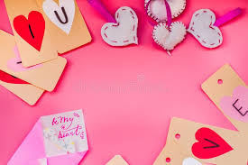 valentine day holiday hand made decorations for a valentine day on pink background