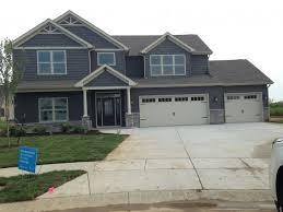 slate blue siding and shakers white trim and garage door