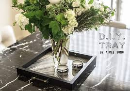 as guest editor for elle this month i did a little diy on turning a picture frame into a tray i love incorporating trays onto pretty much any surface from