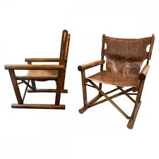 a pair of folding directors chairs by sergio rodrigues 1960s