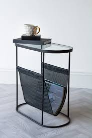 black lozenge shaped glass side table