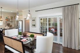 interior white fabric curtains on black steel rod added by glass door on white wall