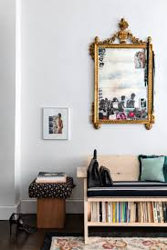 an antique mirror above a plywood bench