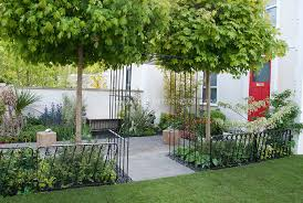 townhouse front entry garden with house red front door wrought iron pretty fence