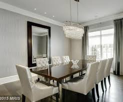 dining room with chandelier high ceiling in bethesda md