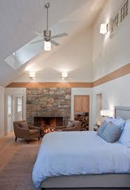 lighting for cathedral ceilings ideas. lighting for vaulted ceilings bedroom eclectic with bed ceiling fan fireplace image by giambastiani design cathedral ideas e