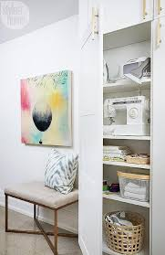 laundry room with tall storage cabinet