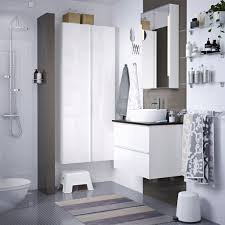white bathroom cabinets. a grey and white bathroom with washstand cabinet. cabinets