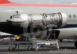 crew repairing jet airplane engine outdoors turbine engine mechanic