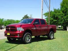 dodge ram 2014 lifted. sweet dodge ram 1500 lifted with muffler i would get different rims but this is a pretty sick truck ram pinterest rams and 2014