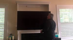 above fireplace drop down tv wall mount custom frame
