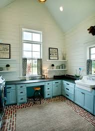 inspiration for a country u shaped brick floor utility room remodel in nashville with a
