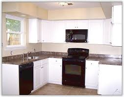 off white kitchen cabinets with black appliances