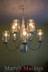 have some extra mason jars and an outdated chandelier turn them into a clever diy we did