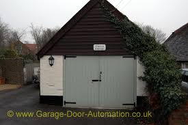 cottage garage doorsSide hinged barn doors  A portfolio of our remote controlled