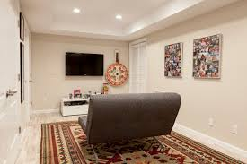 lighting ideas ceiling basement media room. Contemporary Basement Plus Area Rug And Baseboards With Ceiling Lighting Also Flat Screen Tv For Media Room Sleeper Sofa Tan Walls Photo Ideas E