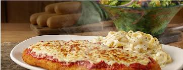 giant en parmigiana served with fettuccine alfredo