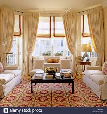 Large Living Room Furniture Large Living Room With Three Sofas Patterned Carpet And Bay